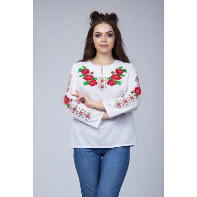 Біла вишита блуза з квітковим орнаментом