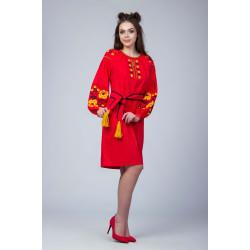 Червона сукня з жовто чорною вишивкою